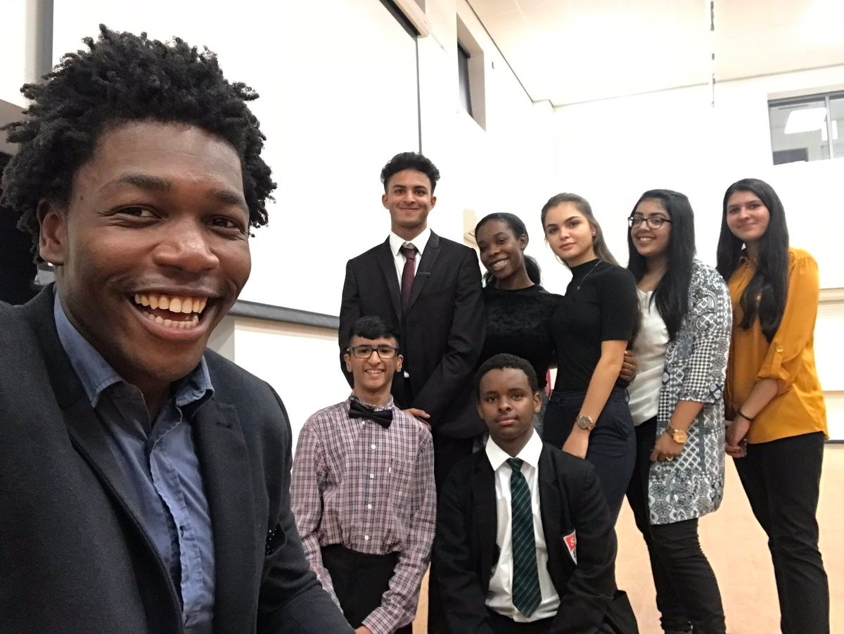 Michael Olatokun with students in Slough